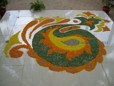A flower rangoli.. and how to make one.