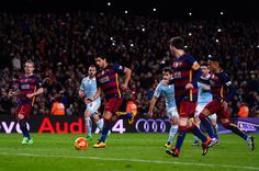 (L-R) Luis Suarez of FC Barcelona celebrates with his team mate Lionel Messi of FC Barcelona after scoring his team's fourth goal from the penalty spot during the La Liga match between FC Barcelona and Celta Vigo at Camp Nou on February 14, 2016 in Barcelona, Spain. Messi took the penalty, tapping the ball softly forward for Suarez to score.
