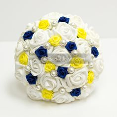 """""""Très Belle """" medium bridal wedding bouquet in white, canary yellow, and royal blue accented with pearl gems and lace  This bouquet is made with with soft white, bright yellow, and royal blue colors and with timeless pearl accents that exude romance from every rose! Made with our signature style Soft Touch roses in white and accented with canary yellow mini roses, and royal blue rosettes throughout. Adorned with beautiful large pearl gems that give it a perfect touch of timeless elegance…"""