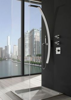 I don't know whether to be wow'ed by this beautiful shower & fixtures or oh wow'ed because the the voyeuristic view.