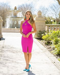 Hot pink dress with bright blue tassel earrings