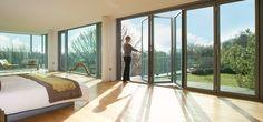 Floor to Ceiling Folding Doors | love these floor to ceiling glass sliding doors.