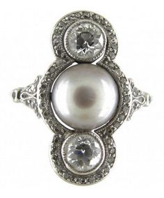 Natural Grey Pearl  Diamond Art Deco Ring Art Deco (1920-1935) A well designed Art Deco ring which features a grey natural pearl surrounded by diamonds with a larger diamond above and below. It is platinum and in very good condition. It was made circa 1920.