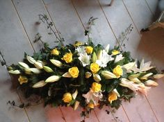 White lily and yellow rose funeral flower spray, coffin spray,casket spray, tabl. White lily and y Funeral Floral Arrangements, Table Flower Arrangements, Table Flowers, Alter Flowers, Church Flowers, Funeral Flowers, White Lilies, Yellow Roses, White Roses