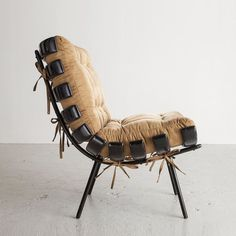 "Martin Eisler's ebonized wood with iron frame lounge chair is currently on view for ""Brazil Modern""."