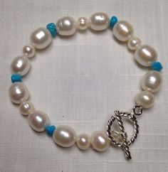 Now listed! Genuine freshwater pearl and Sleeping Beauty Turquoise Bracelet with silver-plated toggle clasp. Simply elegant! www.pearlnleatherjewelry.etsy.com