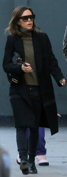 Who made  Victoria Beckham's square sunglasses, black coat, and handbag?