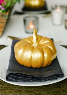 candle, craft, decor, decorated, dinner, family, gold, guest, halloween, handmade, meal, metallic, modern, nobody, painted, party, pumpkin, squash, table, tablescape, thanksgiving, trendy, vegetable. Kirsty Begg for Stocksy United