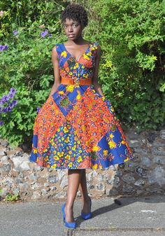 African print midi floral dress in red and blue tones.