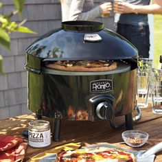 Pizzeria Pronto Outdoor Pizza Oven | Sur La Table-they were demoing this pizza oven in Berkeley today and the pizza was amazing! $299.00 it is only 25 pounds  and runs on propane.