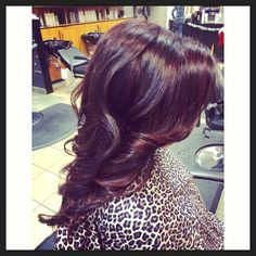 Face framing red highlights on deep red hair