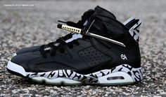 #CustomsOfTheDay  or  Ecentrik Artistry continues with his themed customs by debuting his latest Air Jordan 6 Nightblade Custom inspired by Japanese style Katana swords.  The Katana were one of the traditionally made Japanese swords that were used by the samurai of feudal Japan. This Air Jordan 6 features a simple Black and Silver color scheme that includes a graphic pattern on the heel and midsole completed with Katana swords has hang tags.