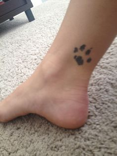 An tattoo of the actual paw print of my cat.