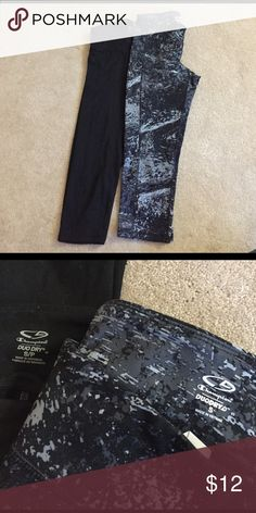 Champion duodry Capri length leggings Selling 2 champion duodry capri length leggings. One is a solid black and the other is a grey and black print. Both are size small Champion Other