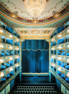 Known for its predilection for Mozart operas, the Estates Theater in Prague unites a charming mix of ceiling paintings, stucco, and papier-mâché.