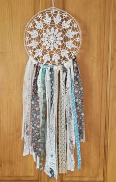 This gorgeous boho crochet dreamcatcher has been made with vintage-style fabrics to give it a classic feel. It looks stunning in any room and is sure to impress your guests.