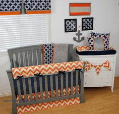 Navy and Orange nautical nursery with chevron and geometric with touches of grey on the crib bedding.