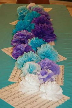 Wedding Shower Table Decorations - Tissue paper flowers over sheet music table runner
