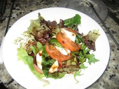 CAPRESE SALAD on MIXED GREENS  The Melting Pot   Mixed field greens topped with mozzarella, Roma tomatoes and fresh basil, drizzled with ...