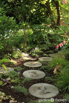inviting and educational stepping stones through the garden for kids to explore.