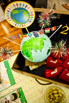 Ideas for a Kid-Friendly New Year's Eve around the world celebration. Different NYE traditions and tablescape fun. #NewYearsEve #KidParties #Parties