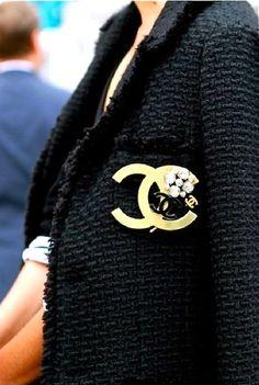 black tweed jacket, chanel brooch