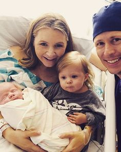 Beverley Mitchell's newborn son Hutton kept cozy as his famous mom cleaned around the house on Friday, Feb. 20