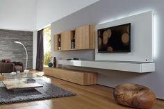 Ein klares, puristisches Gesamtkonzept zeichnet die Wohnwand NEO der Marke hülsta aus. Die hochwertige Anbauwand überzeugt mit grifflosen Fronten und gradlinigen Konturen. Hochglänzende, weiße Fronten stehen im stilvollen Kontrast zu...