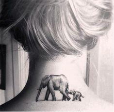 mom and baby elephant tattoo on nape