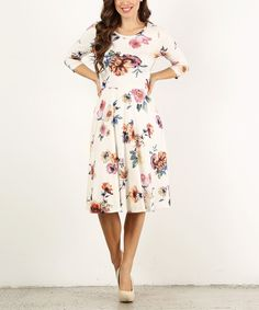 Take a look at this Ivory Floral A-Line Dress today!