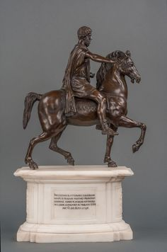 19th century bronze sculpture of Marcus Aurelius on carved white marble plinth. (1820) / View 1: A fine early 19th century bronze sculpture of Marcus Aurelius on carved white marble plinth. Circa 1820 / A fine early 19th century bronze sculpture of Marcus Aurelius on carved white marble plinth. Dimensions: Height with base 39 cm; Height minus base 58 cm; Width 34 cm; Weight: 20kg  /Curator's / Starting Bid: GBP 6,000