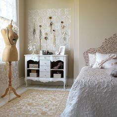 Make a display out of your belongings by stencilling a lace pattern onto a wall and adding some hooks