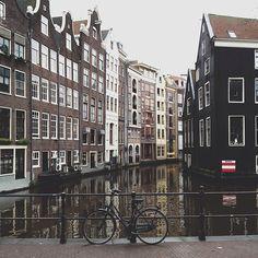 A lonely bike #amsterdam #dewallen. Photo by Alan Jensen