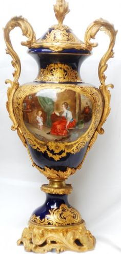 """MEISSEN LARGE TWO-HANDLED VASE BRONZE STAND : Lot 45 finely painted on the front and reverse with NATURE AND WOMAN WITH BABY scenes, signed Fragonard reserved within a gilt cartouche on a cobalt-blue ground WITH BRONZE STAND, crossed swords mark in underglaze-blue, various impressed numerals. SIZE 65 CM X 30 CM OR 25.5"""" x 11.8"""" inches"""