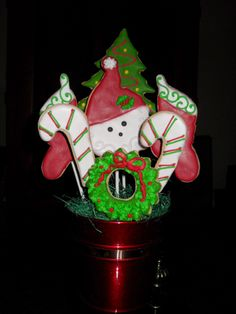 Christmas Cookie Bouquet. Crisp, buttery and Individually hand painted in a Yuletide motif, these cookies make a great centerpiece for your Christmas table.
