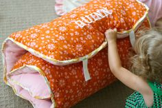 """old comforter as the """"stuffing"""" full sheet folded and sewn up the side and bottom, place comforter piece inside and sew up the end with ribbons long enough to wrap around and tie in a bow."""
