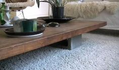 coffee table in Mill Valley, California, made from a walnut drafting-table top and four concrete blocks | remodelista