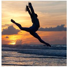 Beautiful mid-air split! I always love doing these whenever I am at the beach and the sun is setting. I think every dancer does!