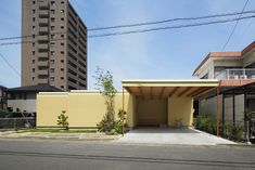 Takeshi Hosaka - Courtyard house, Nagoya 2015. A single story house that navigates an expansive property within a dense urban context with a series of geometric cuts and overhangs, creating a...