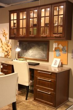 Kitchen Office, like the file drawers, but would make the cabinets above the desk functional not a showcase