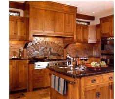 LIke:Swan Mural  (maybe just behind cooktop) interesting hood design, Like kitchen pulls.All wood instead of some white cabinets might be too dark for our space. Great craftsman details.