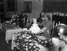 November 30, 1945. Bette Davis and Robert Sherry cutting the cake at their wedding reception at the Mission Inn, Riverside, CA