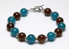 Glow In The Dark Blue and Brown Glass by larissannbeadsbyhand