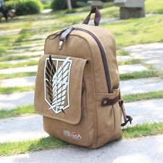 This canvas backpack with a cool and unique design has beautiful illustrations of the Attack on Titan survey corps symbol. Made of high quality canvas, the bag is suitable for daily usage and has comp Men's Backpack, Canvas Backpack, Leather Backpack, Neko, Casual Cosplay, Attack On Titan Anime, Attack On Titan Merch, Shoulder Bags For School, Things To Buy