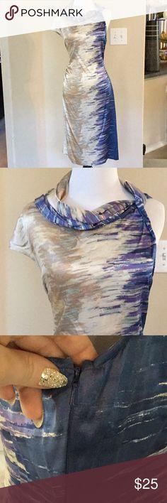 92% silk, 8% spandex . Side zipper Pretty pattern, pics don't do it justice.😁 BCBGMaxAzria Dresses