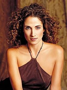 Curly Hair Style. Melina Kanakaredes. Long Brown Extremely Curly Hair Style Picture.