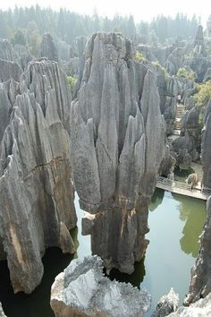 The Yunnan Stone Forest in China. Arrayed across acres. It is a region festooned with stone stalagmites, caves and other natural wonders. Places Around The World, The Places Youll Go, Places To See, Beautiful World, Beautiful Places, Wonderful Places, Beautiful Smile, Amazing Places, Beautiful Pictures