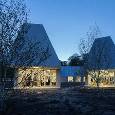 These studios added to a college campus in Skive by MOS Architects are clad in cement panels and feature steeply pitched roofs that reference its neighbours