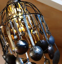 Create this cool kitchen chandelier with an assortment of ladles, sieves and spoons