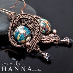 DEAL OF THE DAY... was $70! These wire wrap lampwork earrings feature large and bold hand made art glass centerpieces, with swirling hues of green, blue, yellow and deep maroon. Earrings measure just over 5cm, including the black Swarovski crystal bead dangle (excluding ear wire). Ear wires ar...